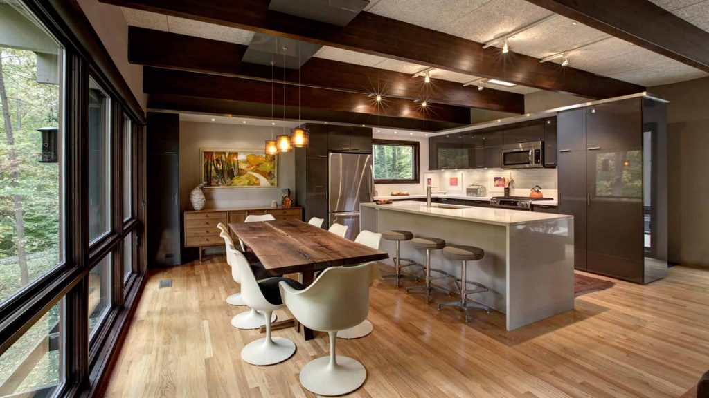 Exposed beams, oak flooring, IKEA kitchen cabinets, waterfall top island, floor to ceiling windows - Midcentury Modern Kitchen Renovation - Bramshaw - Devonshire Neighborhood - Indianapolis