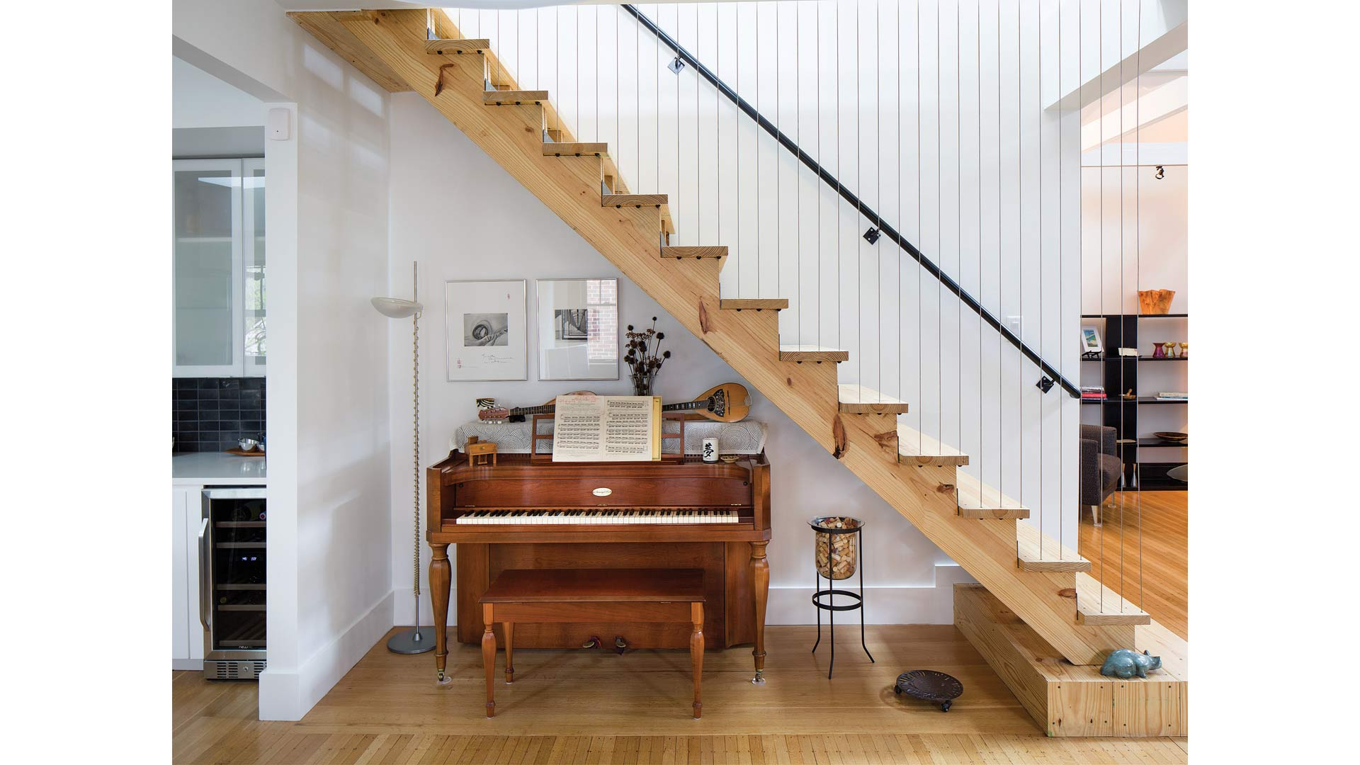 New stair incorporates vertical cable railing for side guard and integrates with piano below - Broad Ripple Modern Craftsman Dwelling on Carrollton Avenue - Indianapolis, Indiana