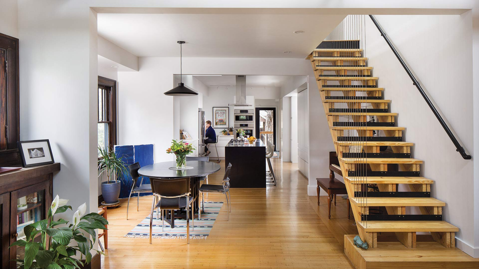Dining, Open Riser Stair, and Kitchen are integrated into new open concept plan - Broad Ripple Modern Craftsman Dwelling on Carrollton Avenue - Indianapolis, Indiana