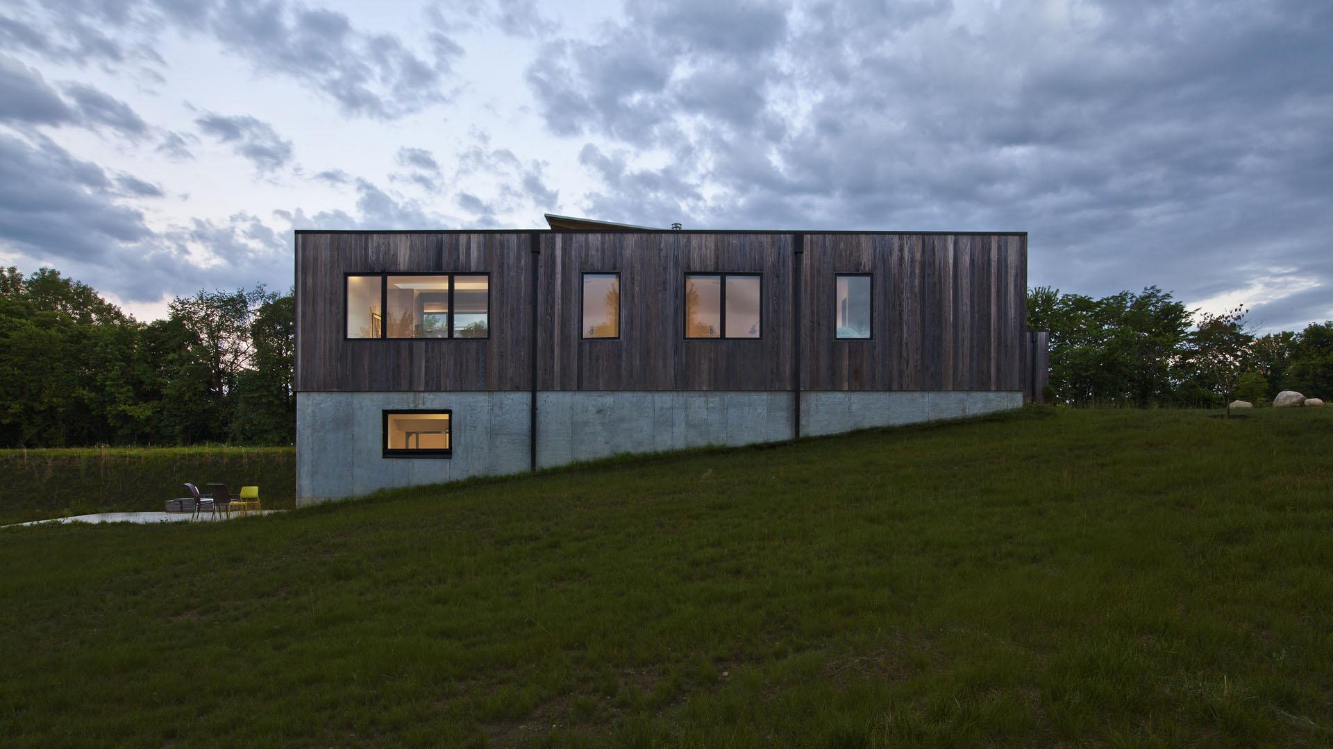 East Exterior Elevation (dawn) - Dezeen Magazine Features WERK Project - New Modern House 1 (Copperwood) - Zionsville, IN