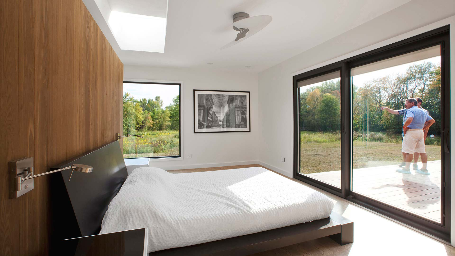 Master Bedroom with skylight, large windows with views to property, and thermally treated partial height wall separating master spa - Privacy partition beyond provides privacy to toilet - New Modern House 1 (Copperwood) - Zionsville, IN