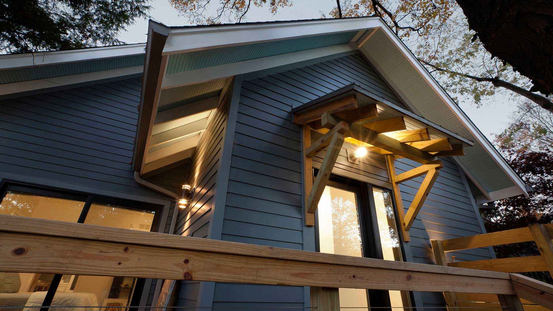 Both Master Bedroom and Mudroom open to the new back porch with extended roof overhangs, tapered exposed rafter tails, and bracketed shed porch roof in this newly reconstructed Broad Ripple Modern Craftsman Dwelling on Carrollton Avenue - Indianapolis, Indiana