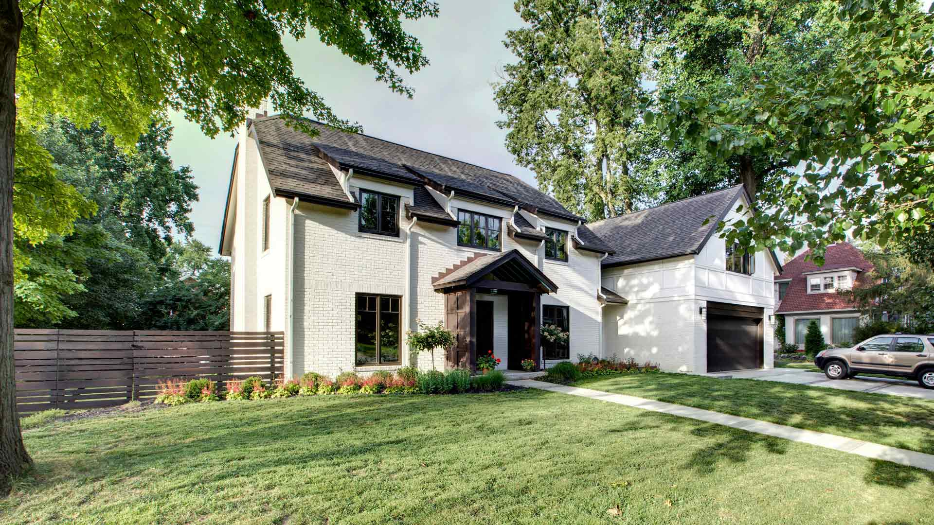 Front Exterior Elevation features new gable entry porch and Addition - Butler Tarkington Modern Tudor - Indianapolis, IN
