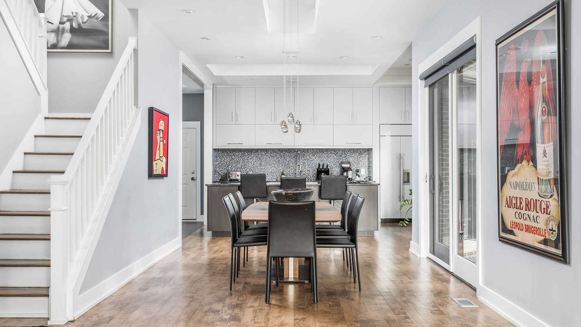 New Modern Kitchen + Dining space with new sliding door in-place of original dark kitchen - Chatham Arch Renovation - Indianapolis, IN