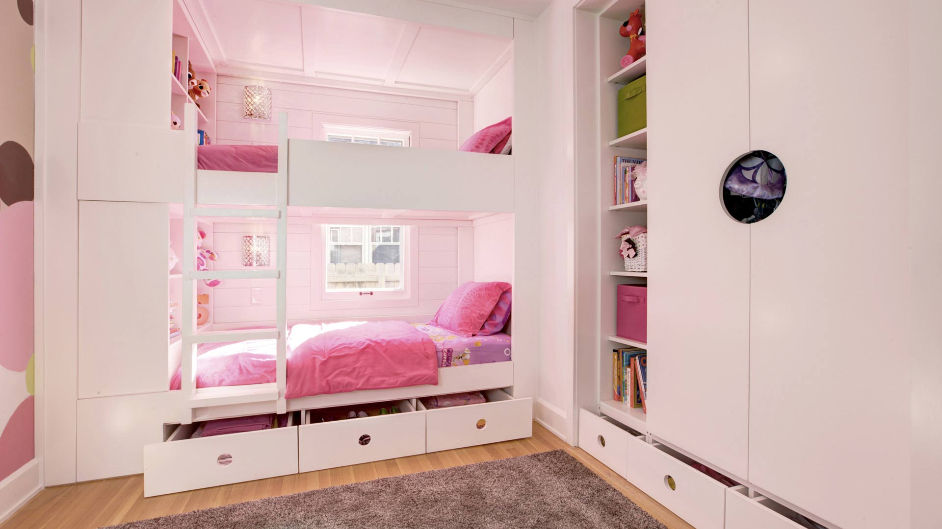 New custom bunk beds include cubbies for display, drawers for storage, and custom closet for toys and clothes - Classic Irvington Tudor Remodel - Indianapolis, IN