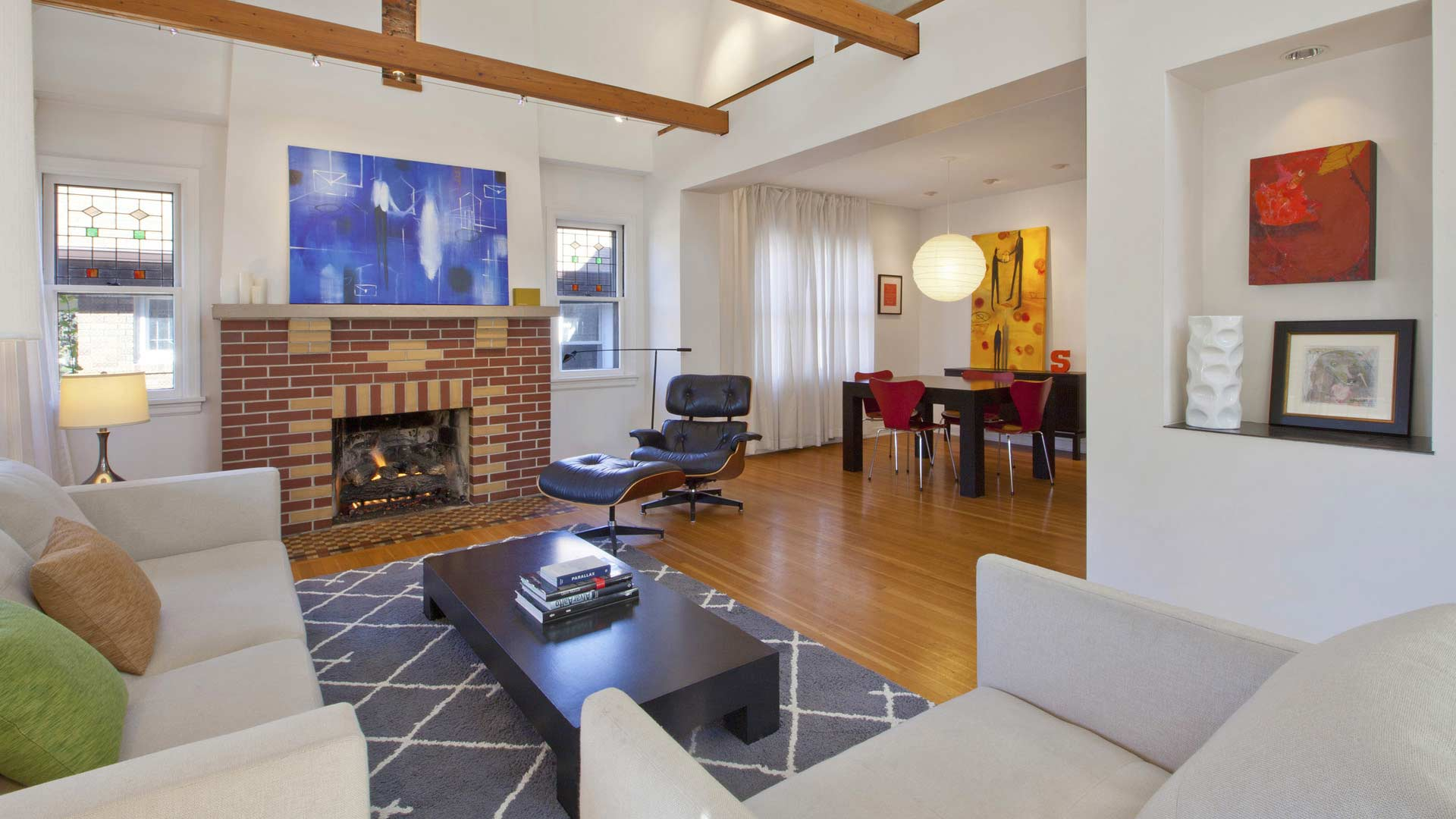 Renovated Living space adds vaulted ceiling with exposed beams, art niche, and new modern details - Classic Irvington Tudor Remodel - Indianapolis, IN