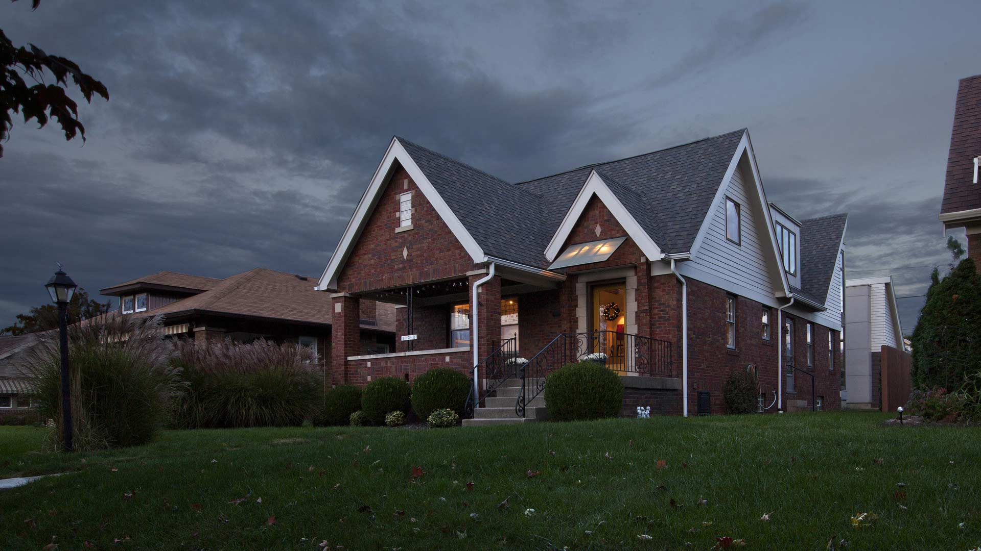 Front Exterior Elevation at Dusk - Classic Irvington Tudor Remodel - Indianapolis, IN