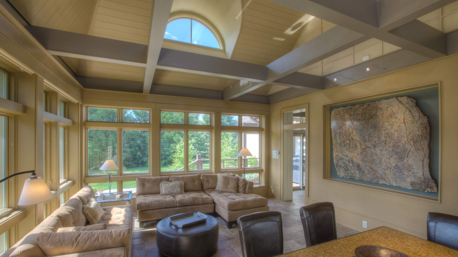 Sunroom View with exposed beams, half-round dormer, and floor to ceiling windows- Kitchen and Family Room Addition - Indianapolis, IN