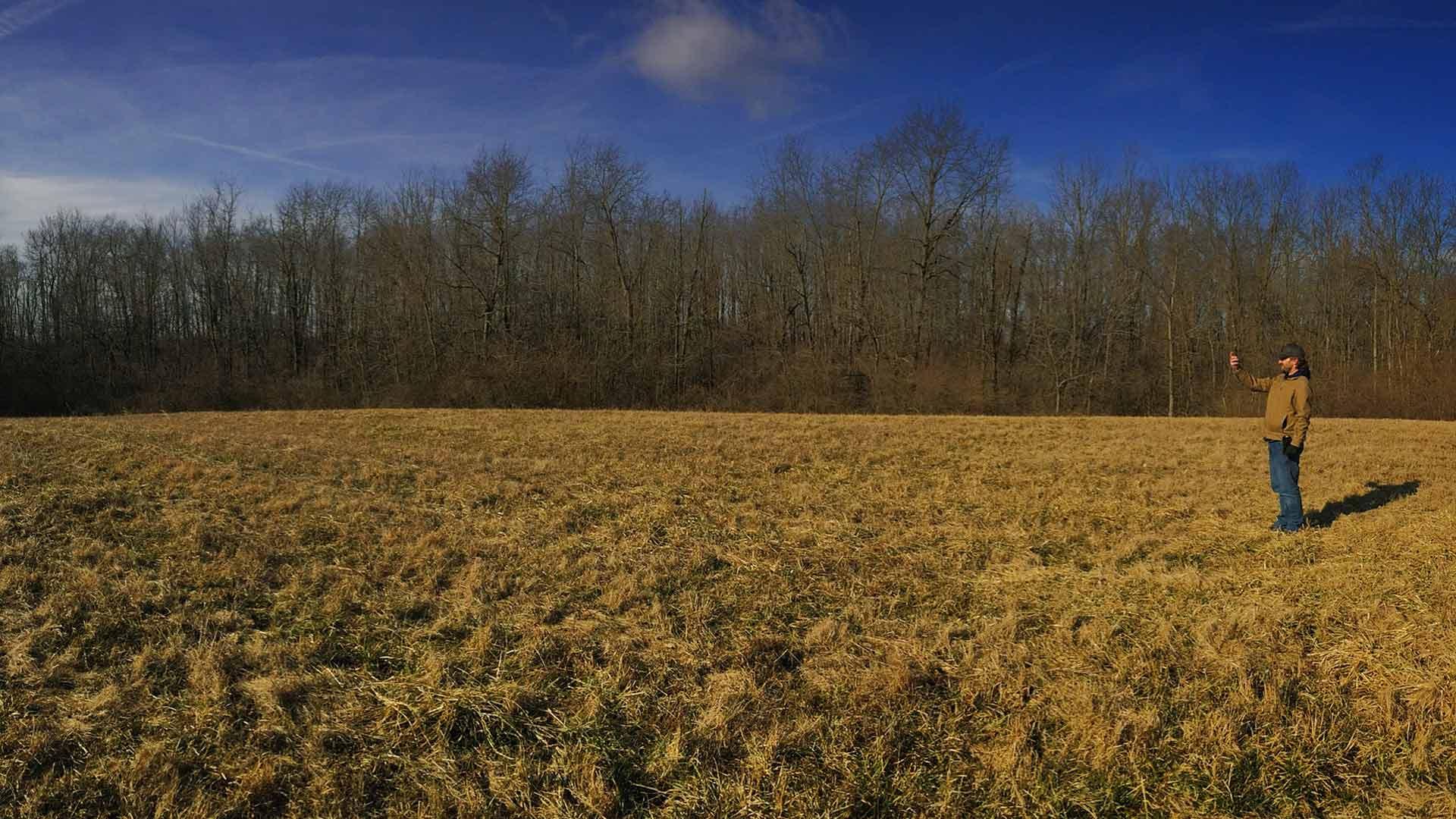 Brad Hayes surveying the property (February 2019) - Back40House - Pendleton, IN