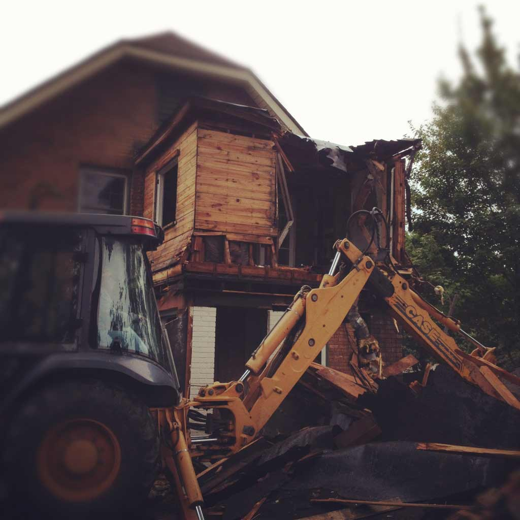 Previous addition demolition is nearing completion - Butler Tarkington Modern Tudor - Indianapolis, IN