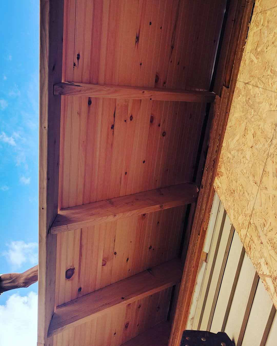 Broad Ripple Craftsman Renovation – The next rafter tails and soffit decking on display for the first time - Modern Craftsman Renovation - Indianapolis, IN