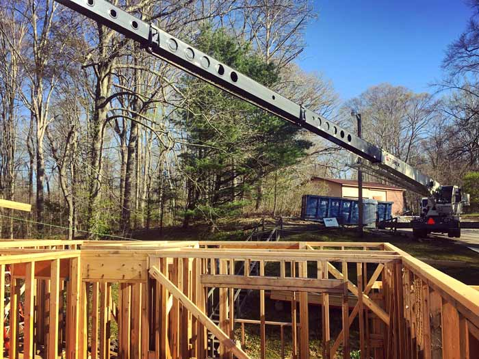 Crane maxed-out it's reach during the roof truss installations due to the sloping site and limited staging access points – Lakeside Modern Cottage (H-LODGE) - Unionville, Indiana, Lake Lemon