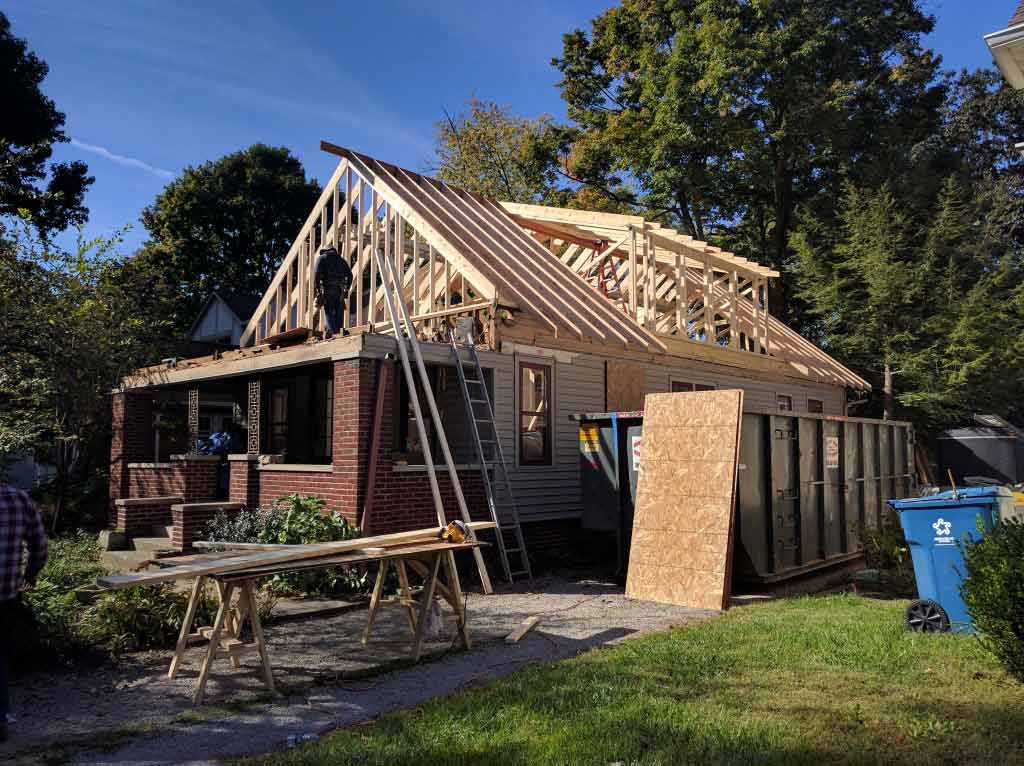Broad Ripple Craftsman Renovation – The roof framing is up and the dormers complete. Ready to begin framing the new porch roof - Modern Craftsman Renovation - Indianapolis, IN