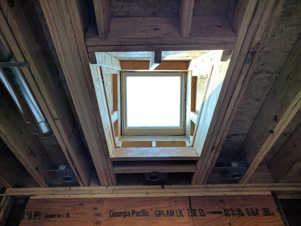 Broad Ripple Craftsman Renovation – It's good to see the morning light pouring into the south-facing skylight. The new kitchen skylight is performing as expected and lighting the interior beneath the opening - Modern Craftsman Renovation - Indianapolis, IN