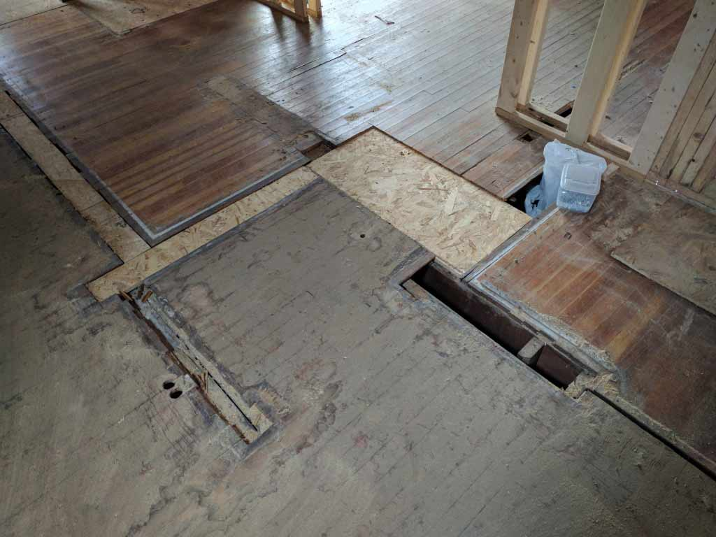Broad Ripple Craftsman Renovation – The mix of materials doesn't make it easy to install the new top-nail oak flooring. Let's see what we can do to tune it up - Modern Craftsman Renovation - Indianapolis, IN