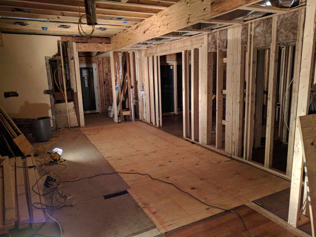 Broad Ripple Craftsman Renovation – The newly installed subfloor, by yours truly, HAUS + WERK. The new subfloor will make the finish flooring go down much easier and provide a solid substrate. Also, note the beginning of fire-safing - Modern Craftsman Renovation - Indianapolis, IN