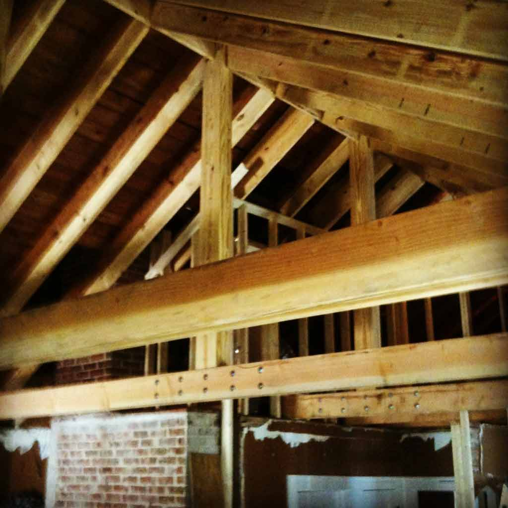 Construction of new vaulted front room ceiling and new site-built king trusses underway - Broad Ripple Bungalow Phase 1 - Indianapolis, IN