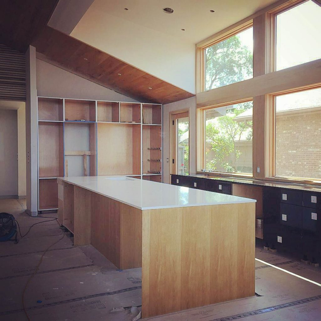 Giant Kitchen Island Construction - Cabinetry Green - John Hartman - Modern Lakehouse Lake Clearwater Indianapolis - Derek Mills, WERK Building Modern, HAUS Architecture For Modern Lifestyles
