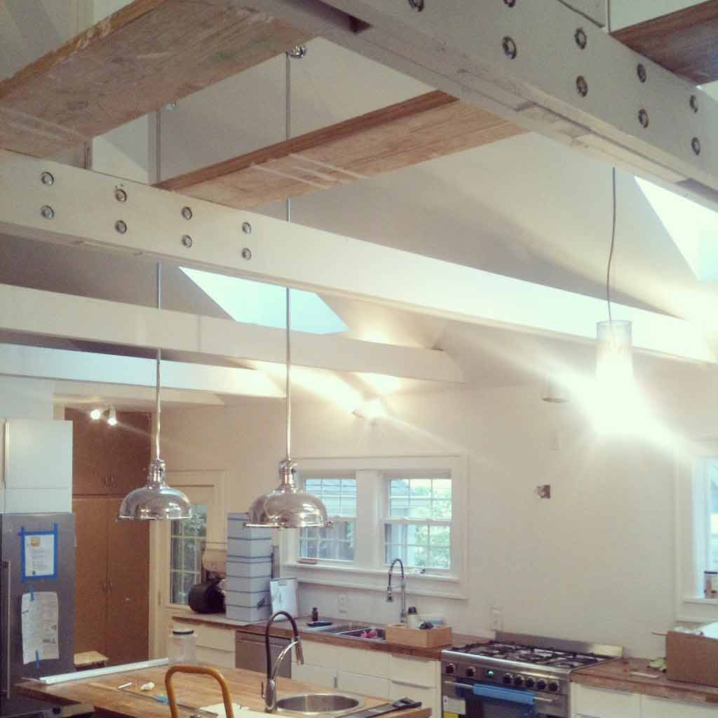Newly Vaulted Ceiling and Site-Built king trusses with pendant lighting and wood countertops (construction progress) - Broad Ripple Bungalow Phase 1 - Indianapolis, IN