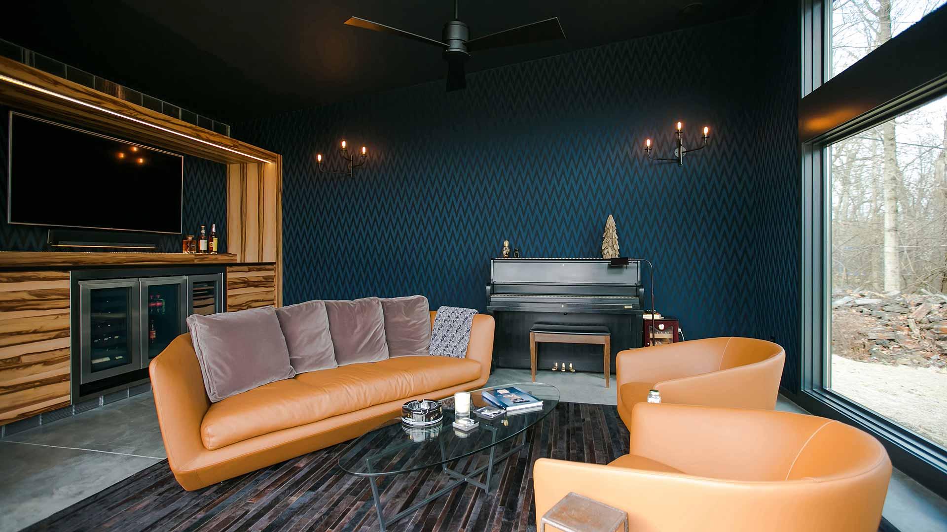 Cigar Room Addition - Piano - Humidor - orange leather sofa - dark wallcovering - Midcentury Modern Addition - Brendonwood, Indianapolis