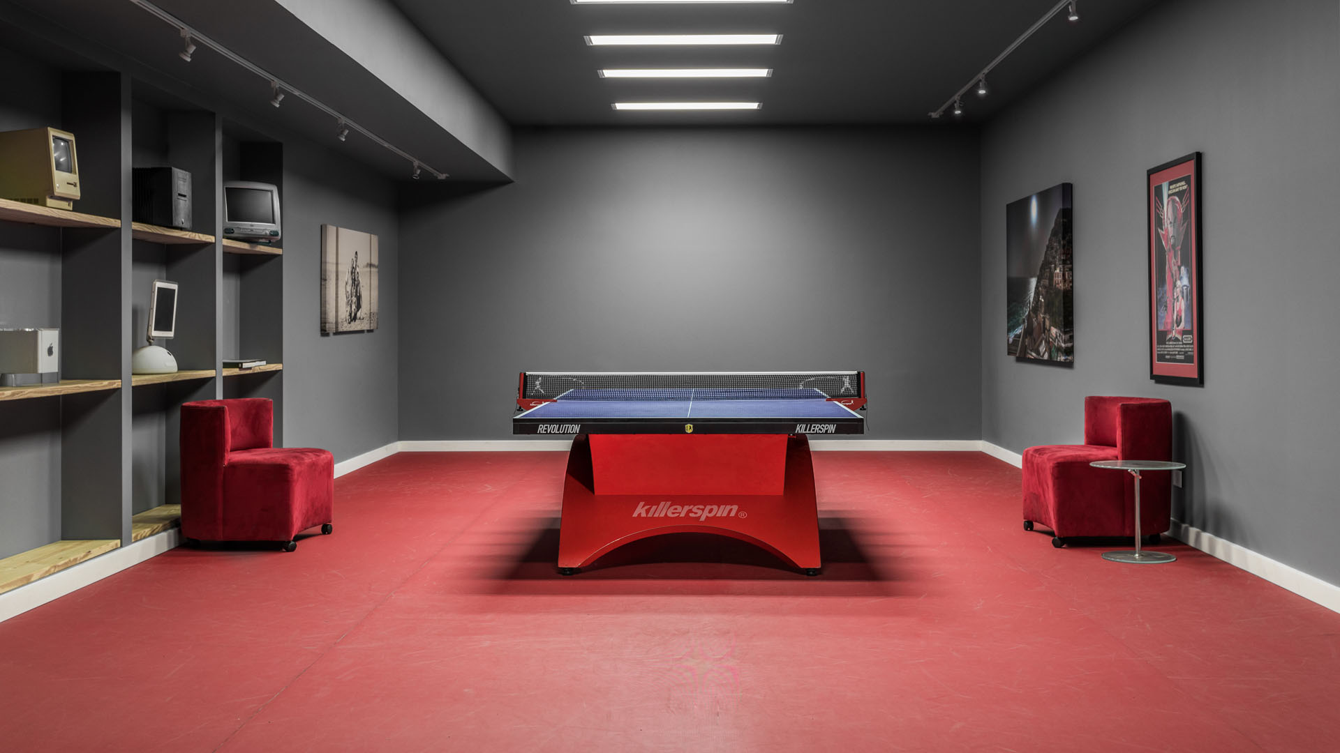 Lower Level table tennis room with red sports floor and vintage Apple Macintosh computer collection - New Modern House 1 (Copperwood) - Zionsville, IN