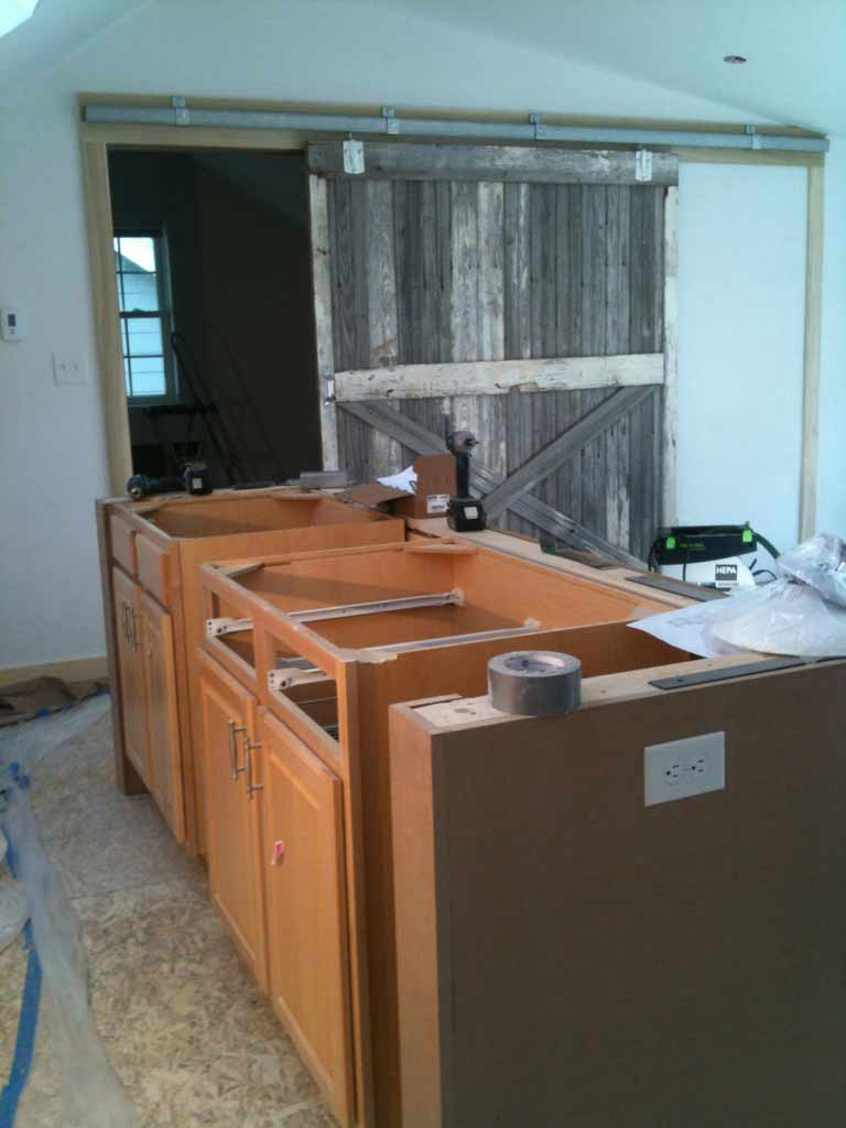 AirBNB loft construction progress - Barn Door Installation and repurposed kitchen cabinetry - Broad Ripple Bungalow Phase 1 - Indianapolis, IN