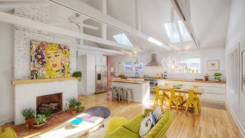 New vaulted ceiling and field-built trusses highlight the new living-dining-kitchen space. New skylights and bay window bring the abundant natural light - Broad Ripple Bungalow Phase 1 - Indianapolis, IN