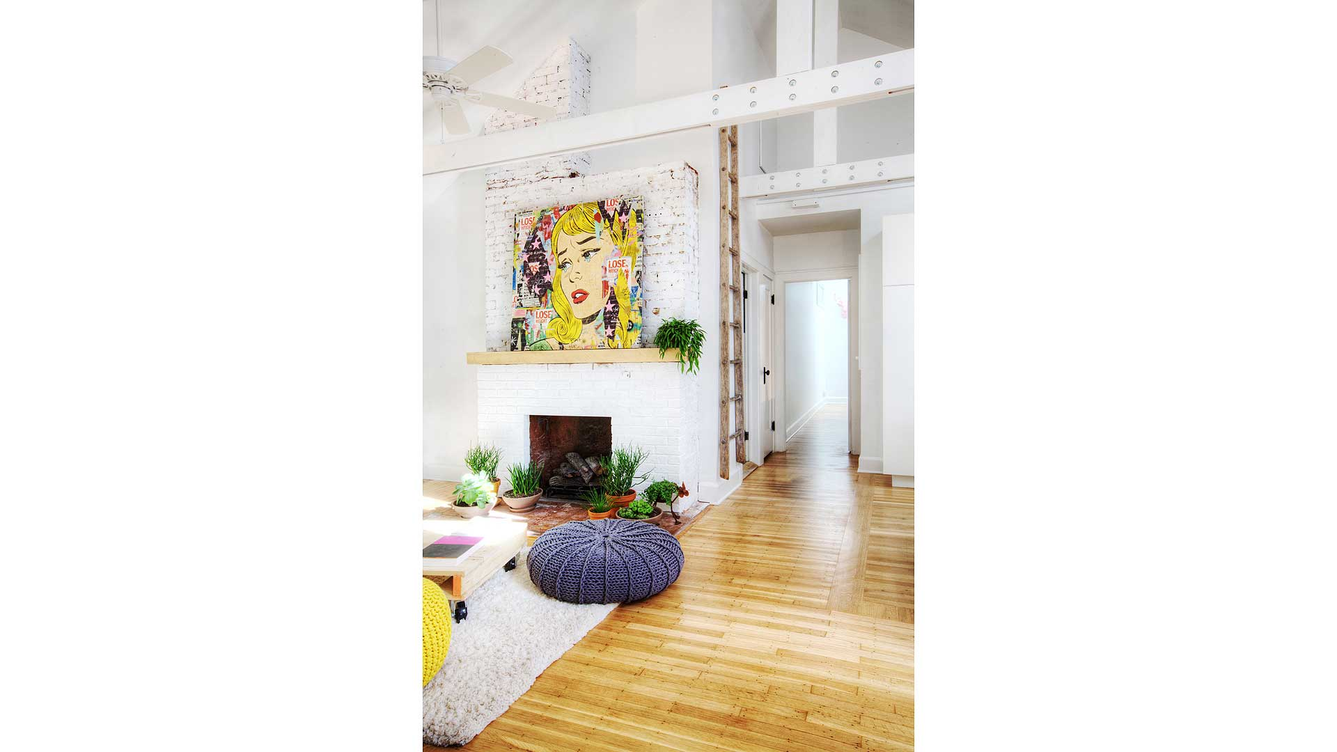 Cover Image - New vaulted ceiling and field-built trusses highlight the new living space that also features exposed fireplace brick, large-format art, and refinished wood flooring - and don't forget the poufs! - Broad Ripple Bungalow Phase 1 - Indianapolis, IN