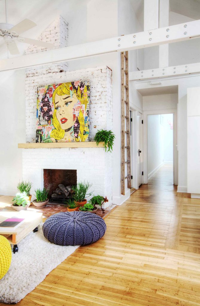 Pop Art - Cover Image - New vaulted ceiling and field-built trusses highlight the new living space that also features exposed fireplace brick, large-format art, and refinished wood flooring - and don't forget the poufs! - Broad Ripple Bungalow Phase 1 - Indianapolis, IN