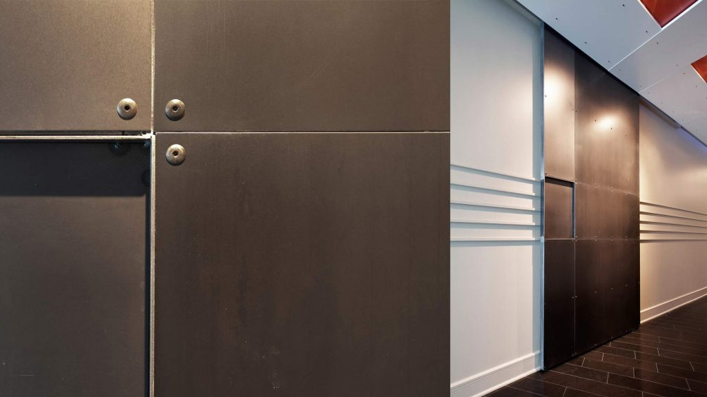 10-foot tall custom steel barn doors added to entry hall to enclose bedrooms, office, closets - Industrial Modern Interior (Allen Plaza) - Downtown Indianapolis