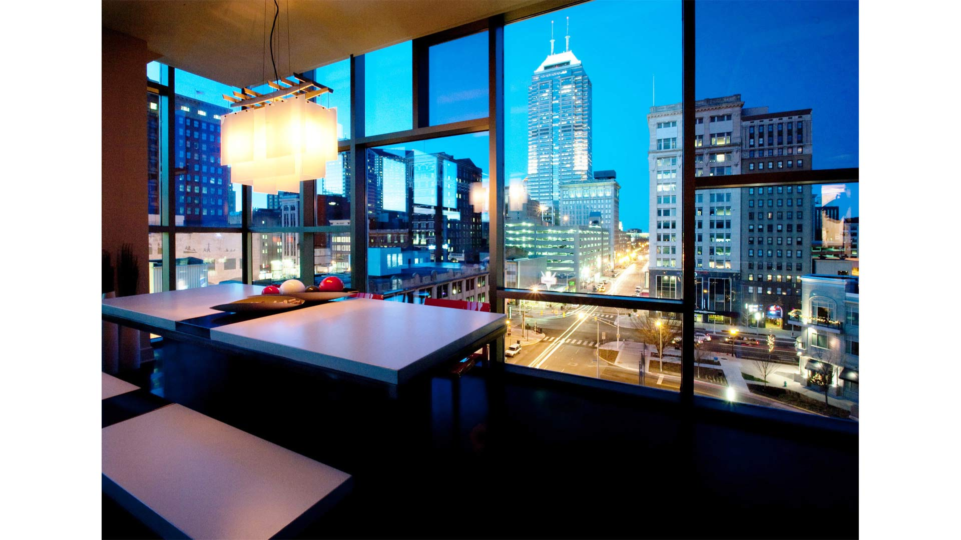 Views to downtown north on Pennsylvania Street include the new custom concrete and steel dining room table (John Beck Steel) - Industrial Modern Interior (Allen Plaza) - Downtown Indianapolis