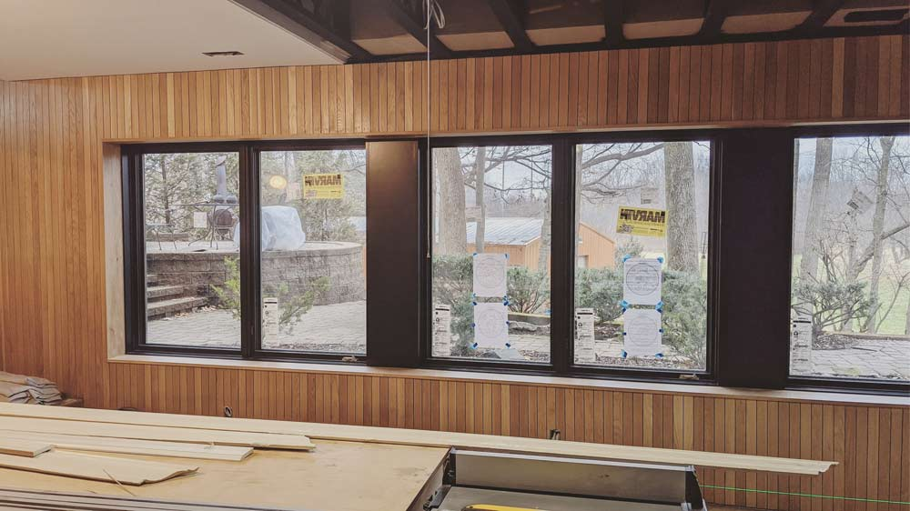 Exterior wall gets a new vertical oak skin + black-clad wiindows - Scandinavian Modern Interior - Indianapolis, IN - Trader's Point