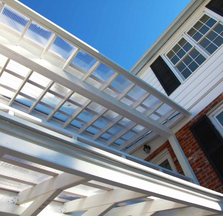 New custom awning structure features exposed structure and acrylic roofing to allow south light into windows while protecting exterior walkway from rain - Custom Awning Structure - Indianapolis, IN