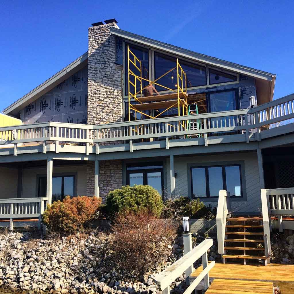 Lakefront elevation getting new windows - Modern Lakehouse Renovation - Clearwater - Indianapolis