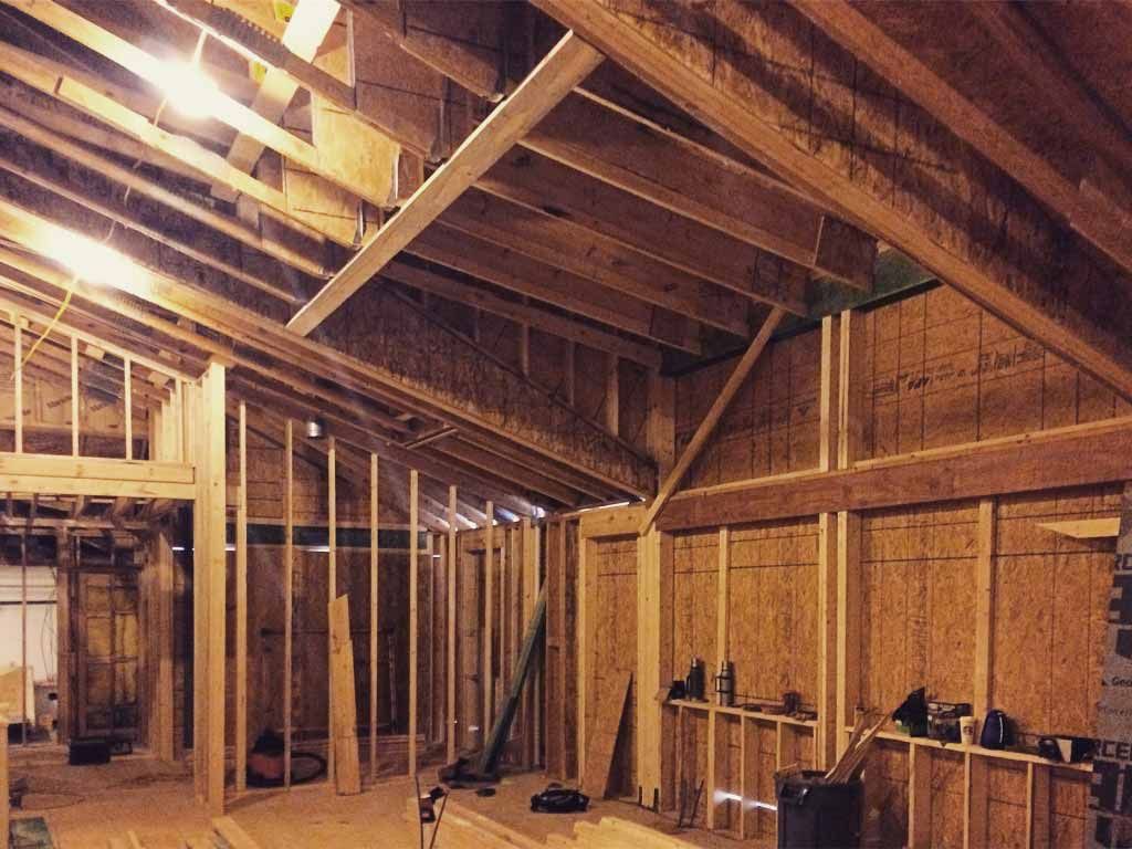 Large south-facing dormer and clerestory framing progress - Modern Lakehouse Renovation - Clearwater - Indianapolis