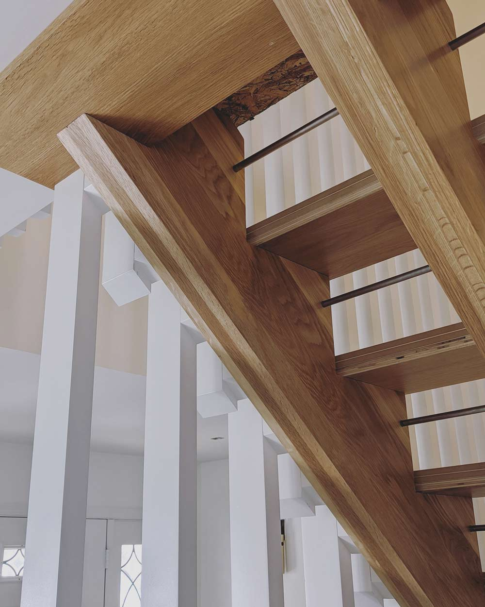 New detailed oak stair includes stainless steel rods to keep open riser openings under 4 inches, and contrasts nicely with vertical painted Poplar slatwall details - Scandinavian Modern Interior - Indianapolis, IN - Trader's Point
