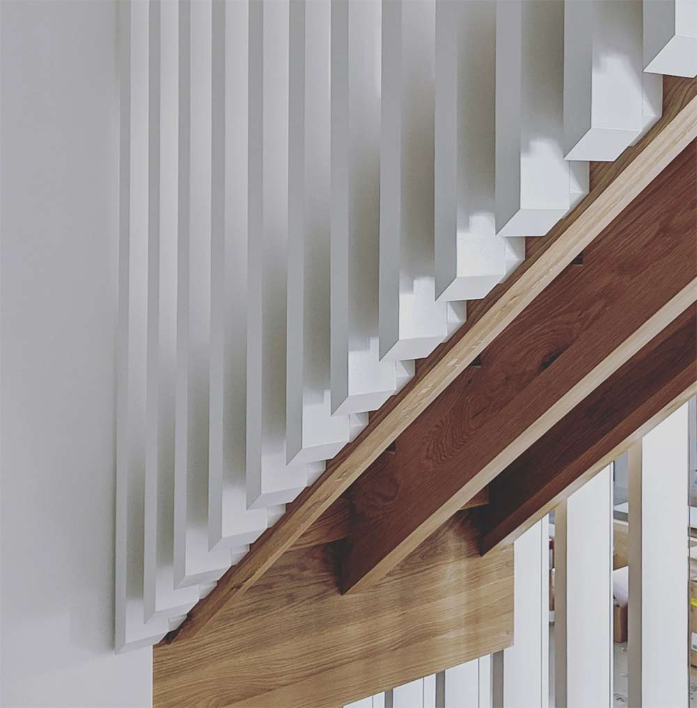 Oak stringers, landing, treads, with Poplar stair guard wall - The detail on this stair must be on steroids - our trim carpenters said we can only do one of these every two years - we must have worn them out - Scandinavian Modern Interior - Indianapolis, IN - Trader's Point