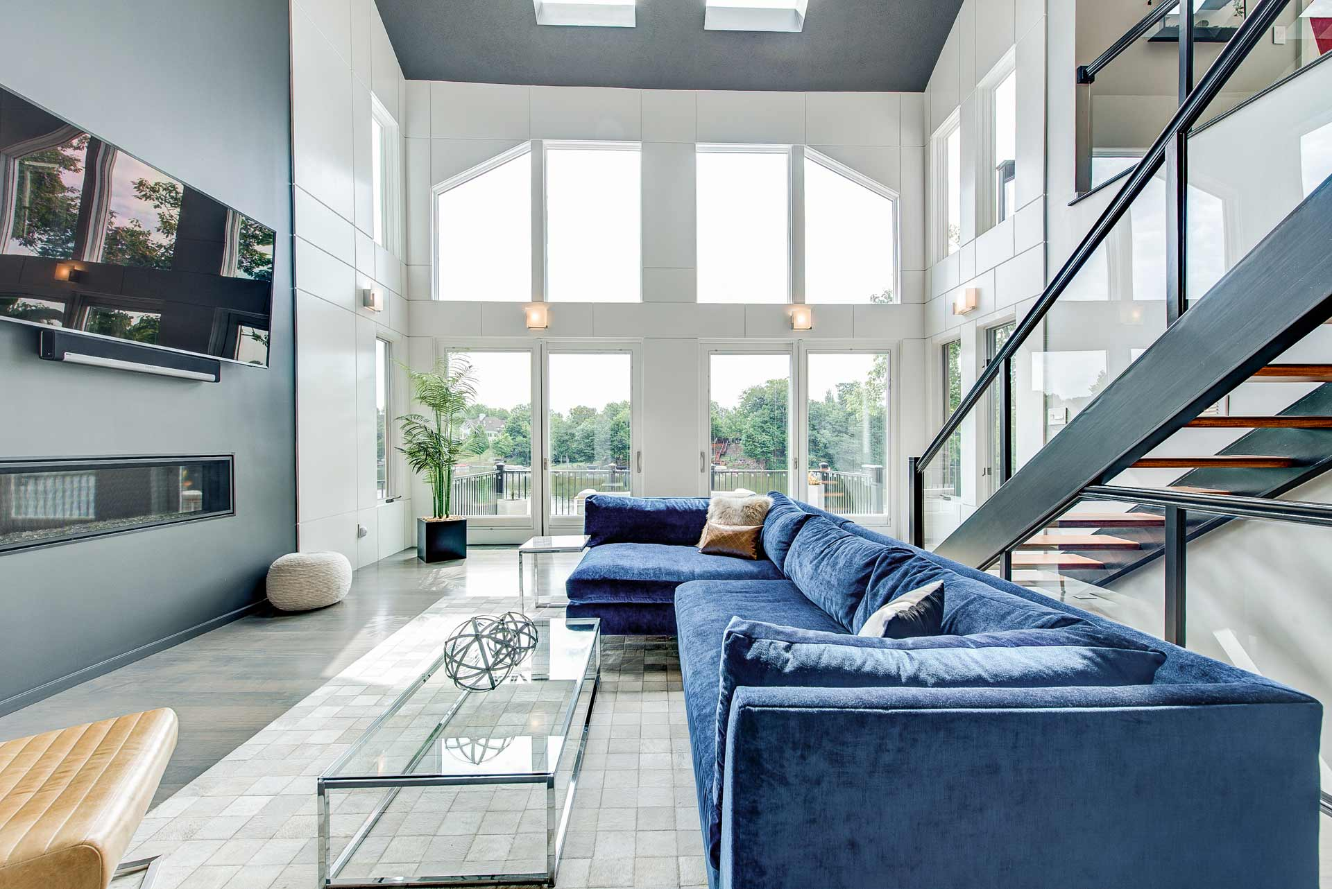 Vaulted Living Space overlooks Geist Reservoir - Reef Court Light Renovation - Geist Reservoir - Indianapolis, IN - Blue Sectional - Photo by Structured Photography