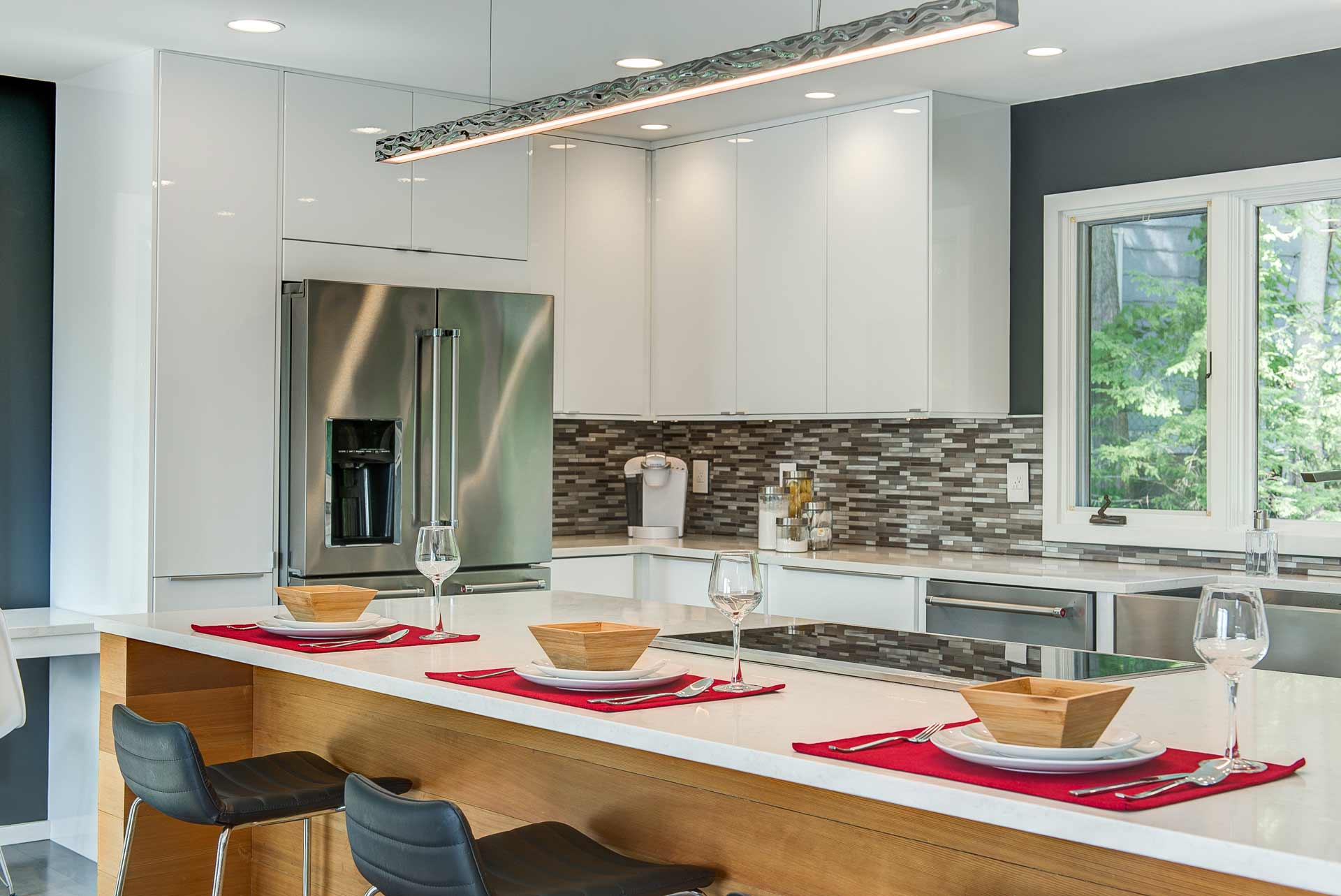 Closeup of kitchen area with place settings/staging - Reef Court Light Renovation - Geist Reservoir - Indianapolis, IN - Photo by Structured Photography