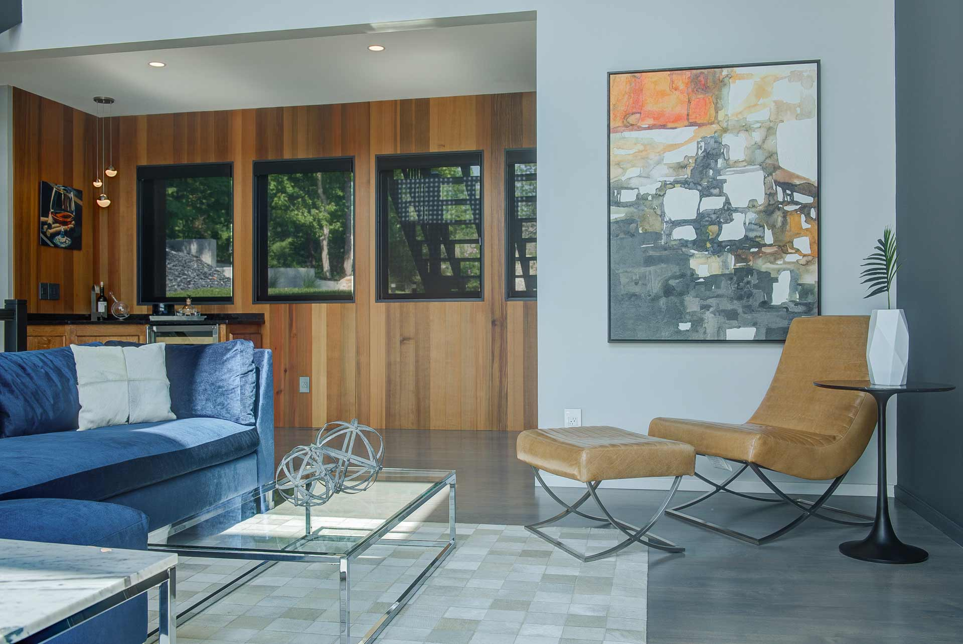 Living space features wet bar ( (blue sectional sofa + yellow leather lounge chair) - Reef Court Light Renovation - Geist Reservoir - Indianapolis, IN - Photo by Structured Photography