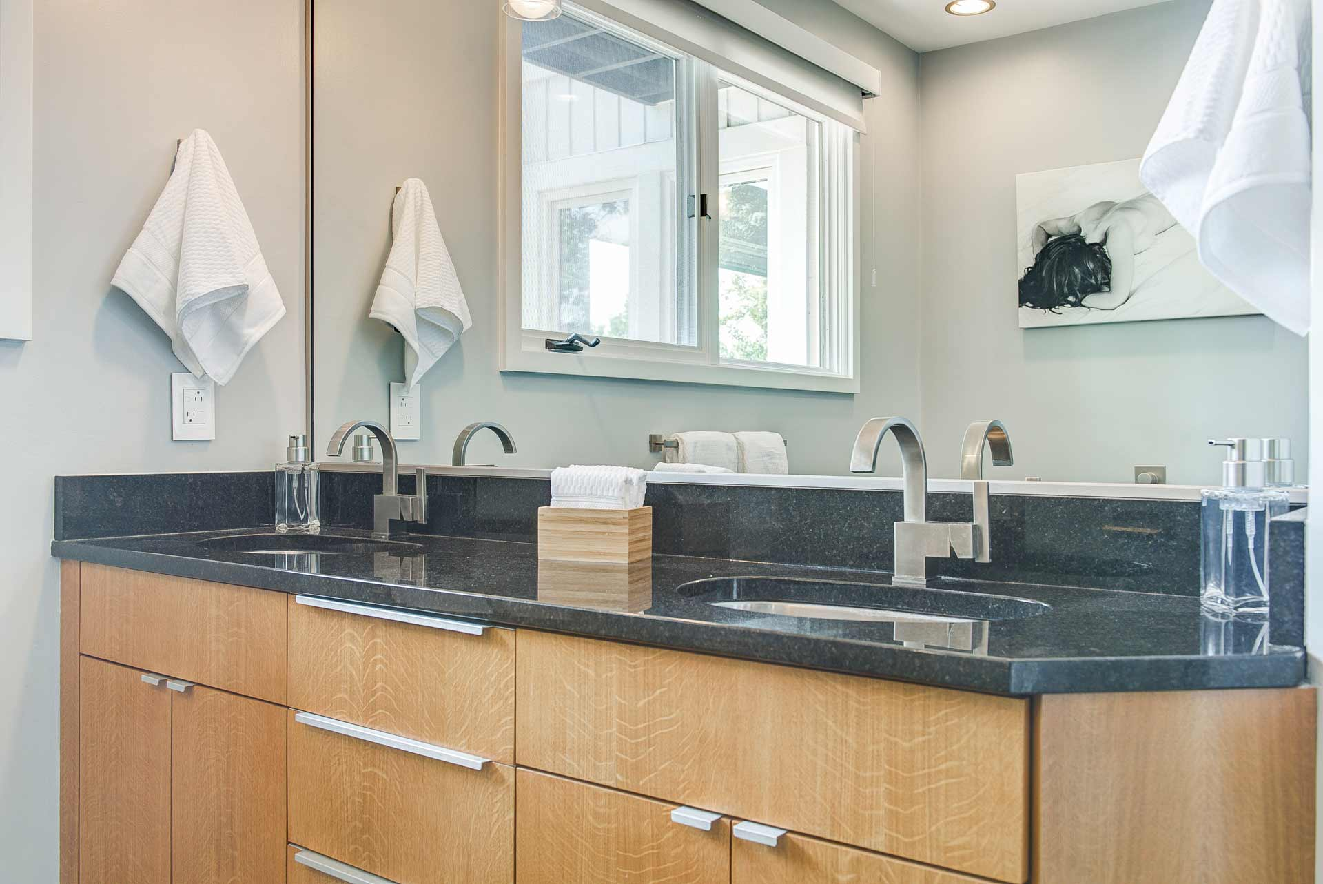 Master vanity details include black quartz top and blonde wood vanity - Reef Court Light Renovation - Geist Reservoir - Indianapolis, IN - Photo by Structured Photography