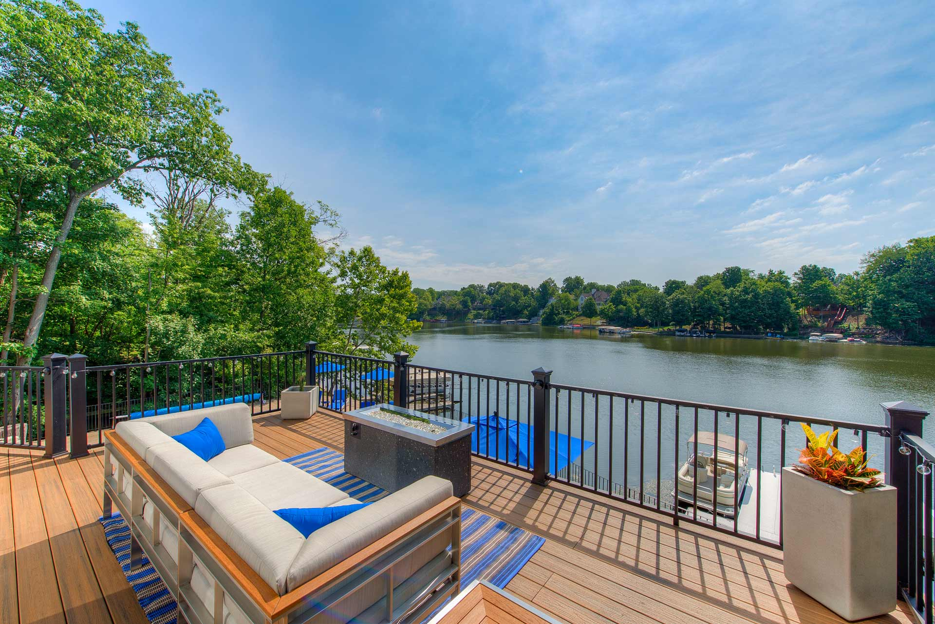 Pool Deck has been enhanced with new railings and composite decking overlooking Geist Reservoir - Reef Court Light Renovation - Geist Reservoir - Indianapolis, IN - Photo by Structured Photography
