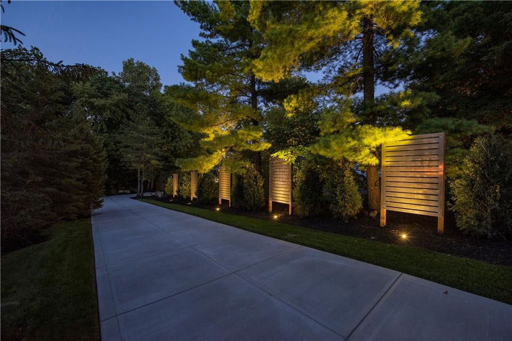 New Modern Fence Panels line the entry drive - accent lighting enhances the experience at night - Reef Court Light Renovation - Geist Reservoir - Indianapolis, IN - Photo by Structured Photography