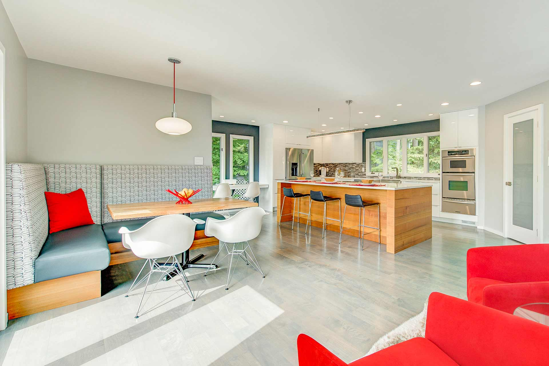 Cedar Wrapped Kitchen Island + White Cabinets and White Quartz Tops - kitchen booth seating - red chairs - Reef Court Light Renovation - Geist Reservoir - Indianapolis, IN - Photo by Structured Photography