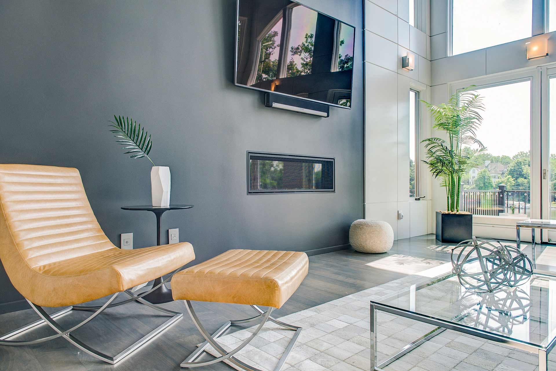 Vaulted living space overlooks Geist Reservoir - new updates include panelized walls - Reef Court Light Renovation - Geist Reservoir - Indianapolis, IN - modern yellow leather chair - Photo by Structured Photography