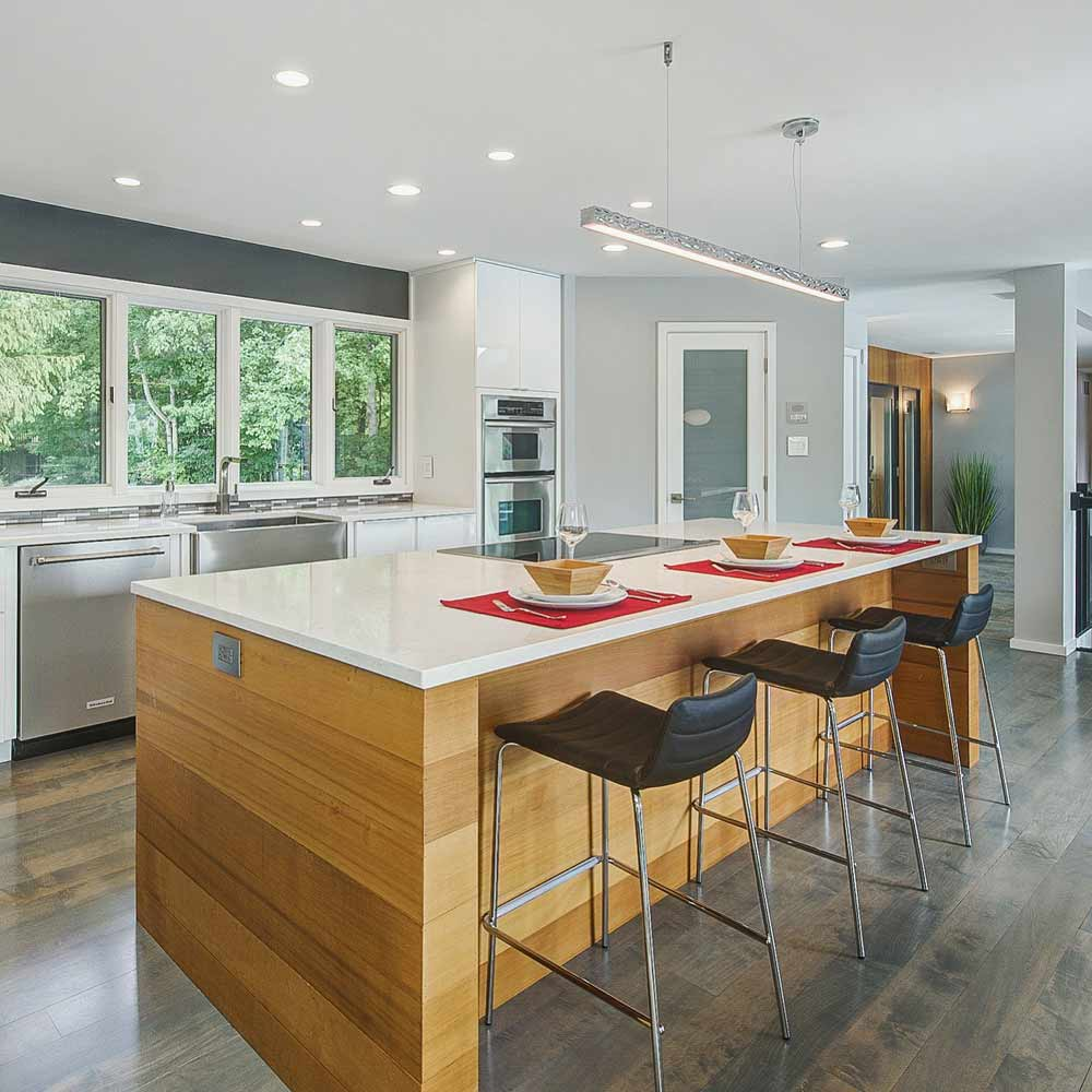 Cedar-Wrapped Kitchen Island with white quartz top - Kitchen Renovation achieves open concept interior - Reef Court - Geist Reservoir - Indianapolis, IN - Photo by Structured Photography