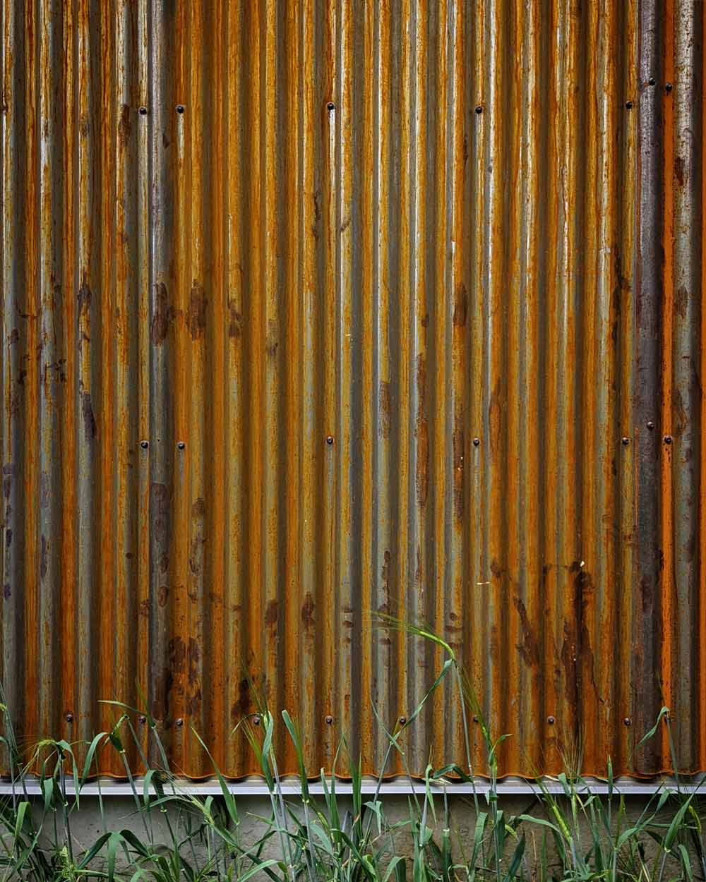 Corrugated Corten steel cladding installation begins to patina - Back40House - Pendleton, IN