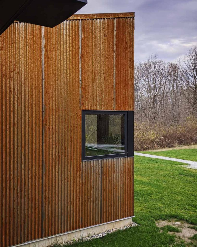 Corten Patina at Back40House - View of Master Suite facade from hot tub enclosure - vertical corrugated Corten steel siding patinas - Back40House - Pendleton, IN
